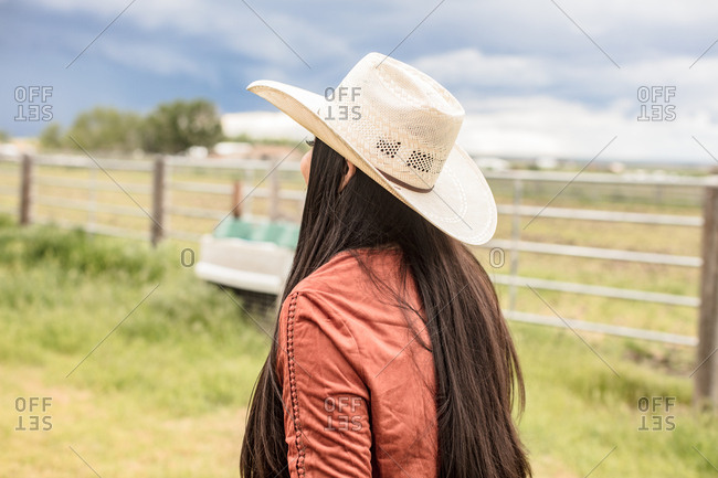Back view of woman in straw cowboy hat