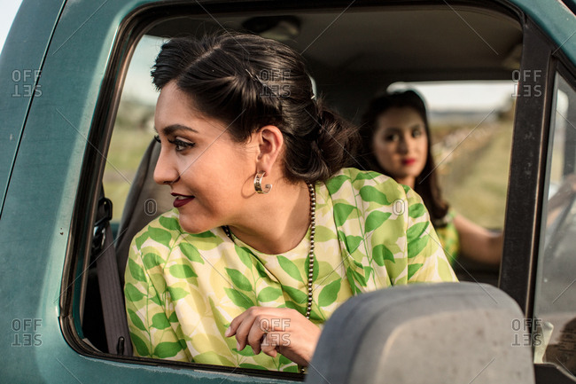 Woman looking out the passenger side of truck