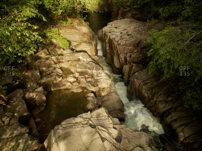 An aerial view of Riam Parit, or Channel Falls, a slot waterfall on the upper Siduk River.