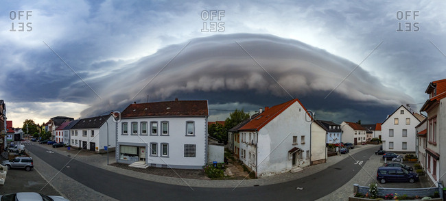 Saarlouis, Saarland, Germany - August 21, 2011: An arcus cloud brings a storm to a town in Germany.