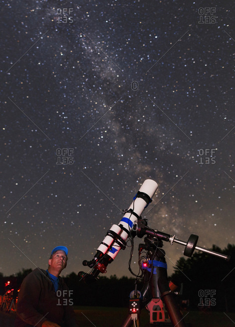 An amateur astronomer viewing the Milky Way in Maine.