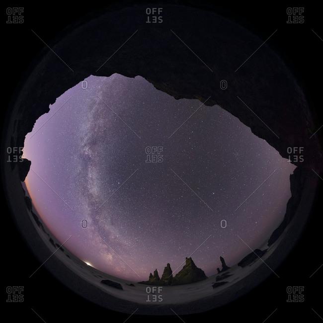 Milky Way over the basalt sea stacks known as Reynisdrangar in Vik, Iceland.