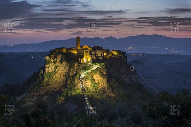 The cliff-top Civita di Bagnoregio, built on volcanic tuff, in morning twilight.