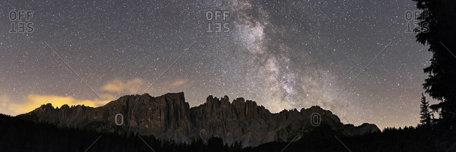 Panoramic of the Milky Way above Latemar Mountain.