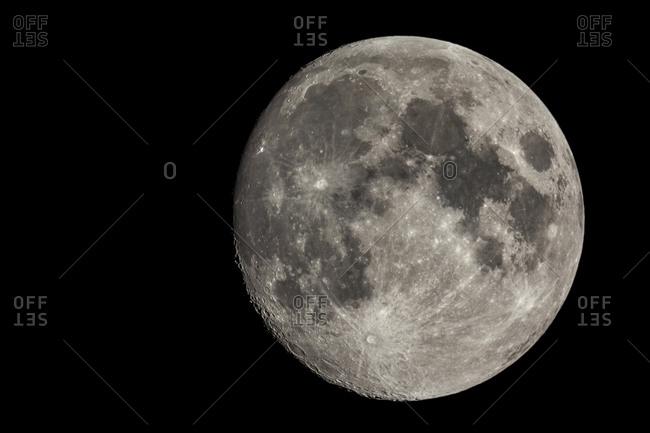 Telescopic image of the waxing gibbous moon.