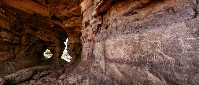 Petroglyph on the walls of a prehistoric cave in Tassili National Park.