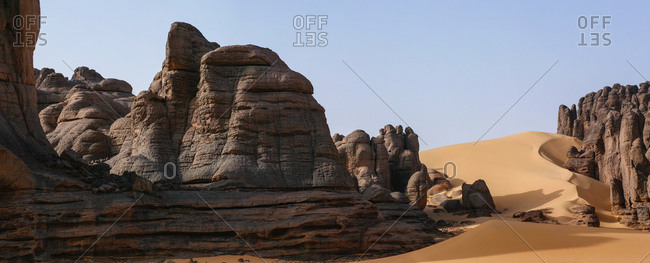 Sand dunes and giant sandstone cliffs in Tassili National Park.