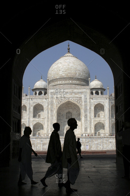Agra, Uttar Pradesh, India - April 1, 2007: Silhouette of visitors at Taj Mahal in Agra, India.