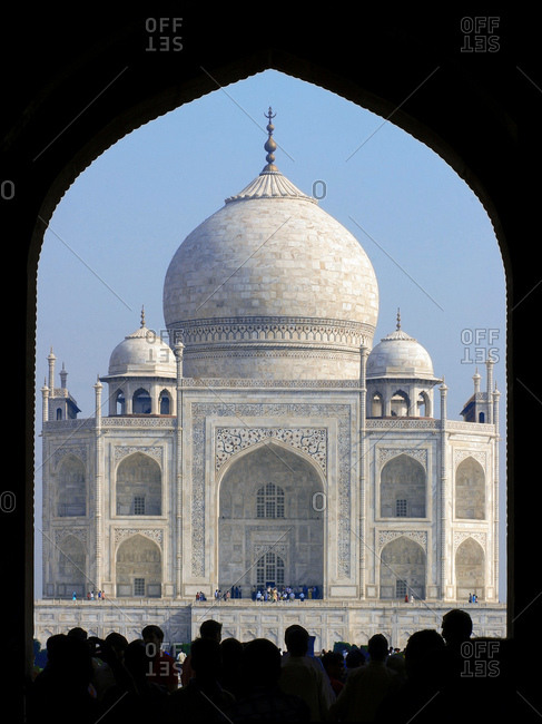 Agra, Uttar Pradesh, India - April 1, 2007: Silhouette of tourist at the entrance of Taj Mahal, India.