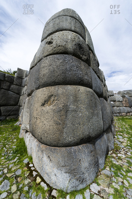 The Inca carved interlocking dry-stone walls from boulders to build a citadel terrace wall.