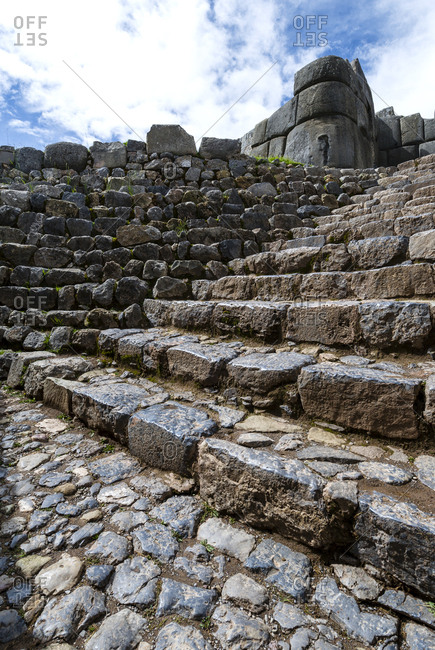 A flight of steps carved from granite boulders in an Inca citadel.