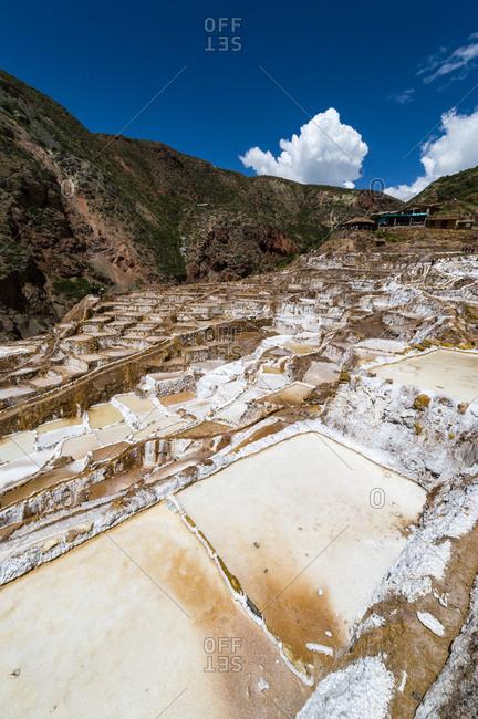 An Inca salt mine made up of salty spring water ponds evaporating.