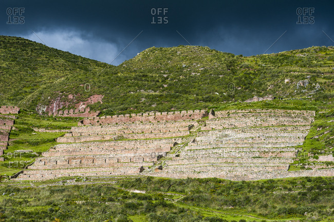 An ancient Incan granery on a hillside where grain was stored in the Andes Mountains.
