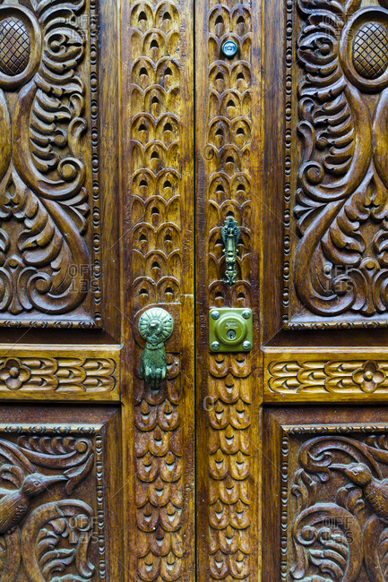 An intricately carved wooden door.