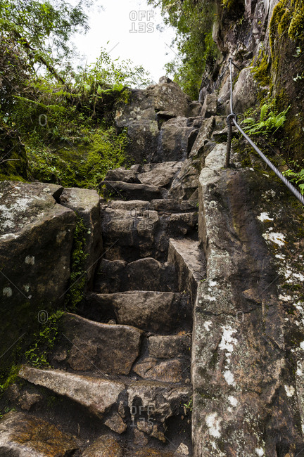 Steep ancient stone stairs carved into the rock by the Inca at Huayna Picchu.