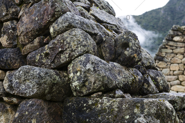 A detail of stones stacked to form a wall in a residential building at Macchu Picchu.