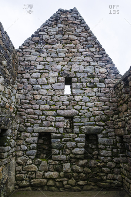 A window in a trapezoidal wall in a residential building at Macchu Picchu.
