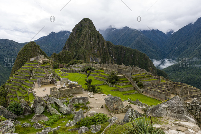 The ancient Inca ruins at the base of Huayna Picchu in the Andes.