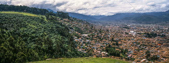 The city and suburbs of Cusco fill an Andes valley with terracotta roof tiles.