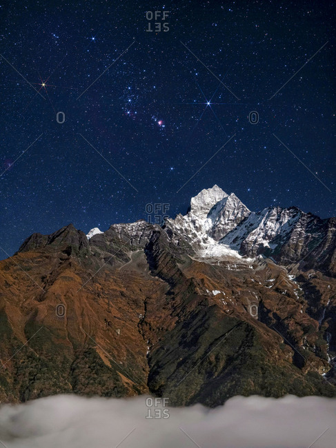 Constellation of Orion, rises above Himalayas in the Sagarmatha National Park of Nepal.
