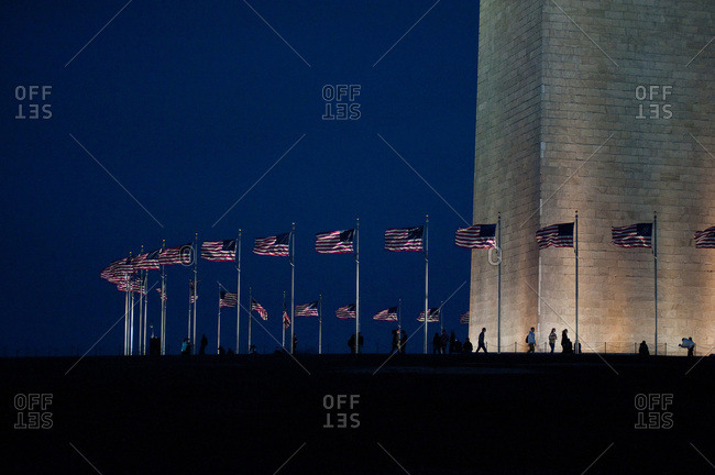 Washington, District of Columbia, United States - January 12, 2017: Flags blow in the breeze around The Washington Monument.
