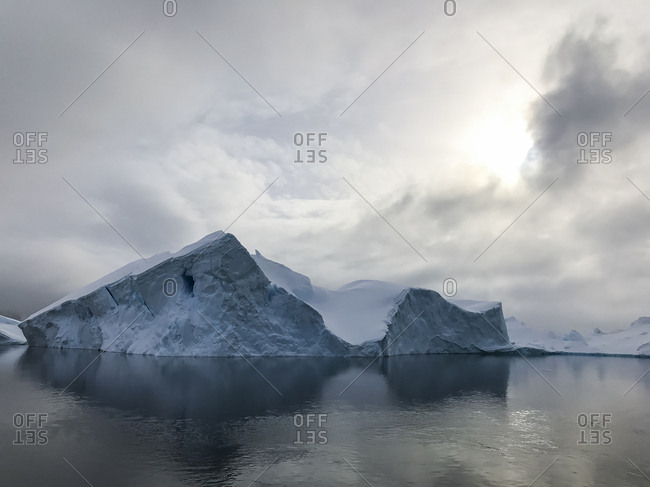 Clouds above icebergs in Antarctica's Lemaire Channel.