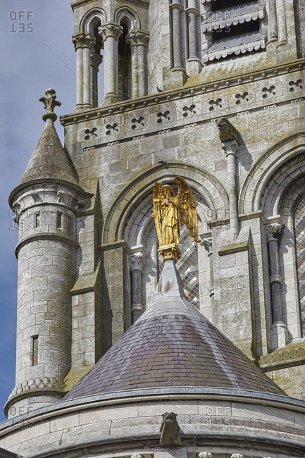 A gold statue on Saint Fin Barre's Cathedral.