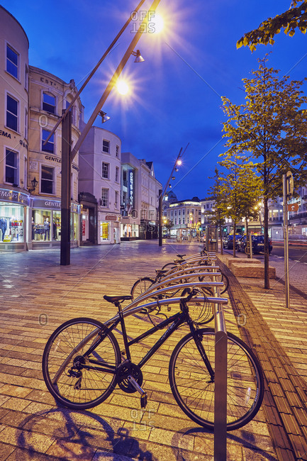 Cork, Ireland - July 21, 2015: A dusk scene on St Patrick's Street in downtown Cork, Ireland.