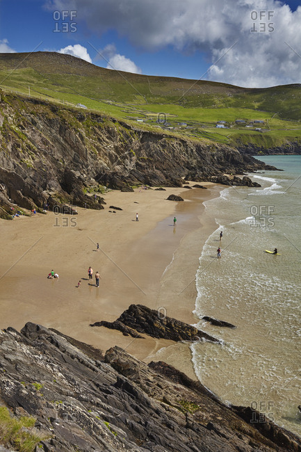 Dingle Peninsula, County Kerry, Ireland - July 24, 2015: Visitors on the beach at Dunmore Head.