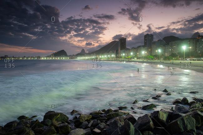 Copacabana Beach in Rio de Janeiro at dusk.