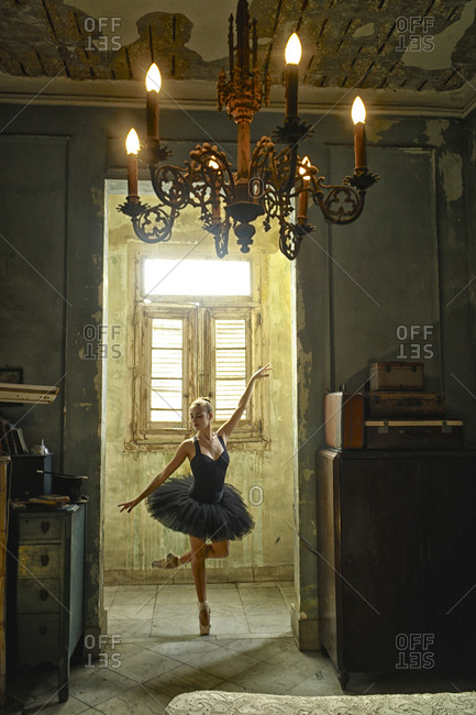 A ballerina from the National Ballet of Cuba in an old house in Havana.
