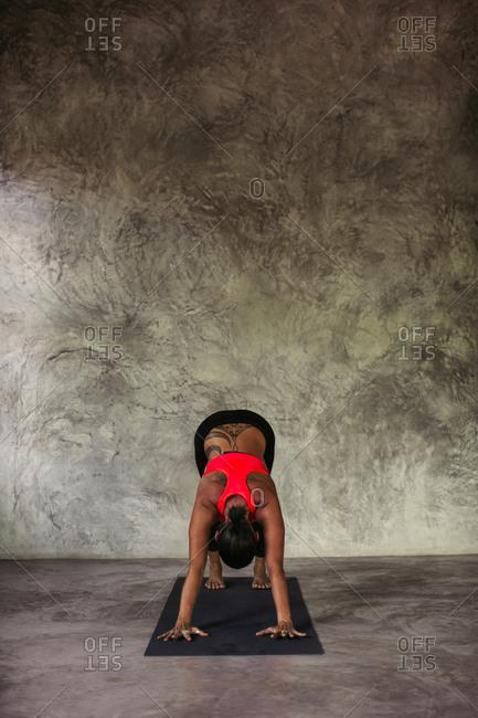 Woman performing a downward facing dog yoga pose