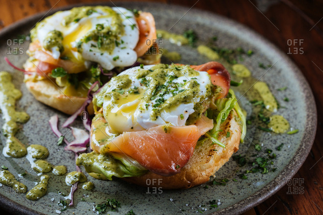 Smoked salmon with poached eggs and herbs on toast