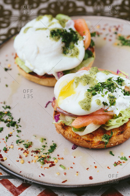 Plate with two poached eggs served on smoked salmon and toast