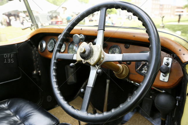 New York City, United States - June 10, 2017: 1920's Jazz Age Lawn Party at Governors Island, Steering wheel and dashboard of a vintage car