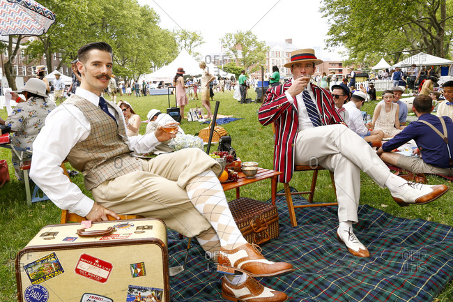 New York City, United States - June 10, 2017: 1920's Jazz Age Lawn Party at Governors Island, Two men dressed in 1920s garb sipping drinks at a garden party