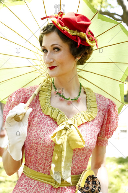 New York City, United States - June 10, 2017: 1920's Jazz Age Lawn Party at Governors Island, Woman in vintage dress and hat holding a parasol