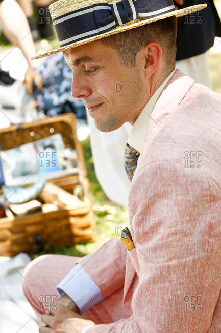 New York City, United States - June 10, 2017: 1920's Jazz Age Lawn Party at Governors Island, Man in a vintage suit and straw hat at a 1920s-themed party