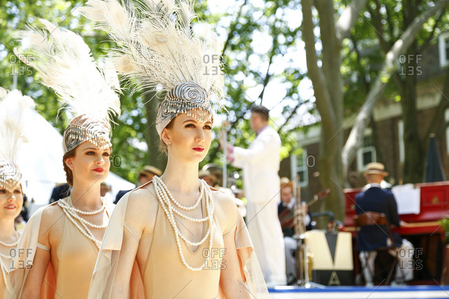 New York City, United States - June 10, 2017: 1920's Jazz Age Lawn Party at Governors Island, Showgirls with feathered headpieces at a 1920s-themed garden party