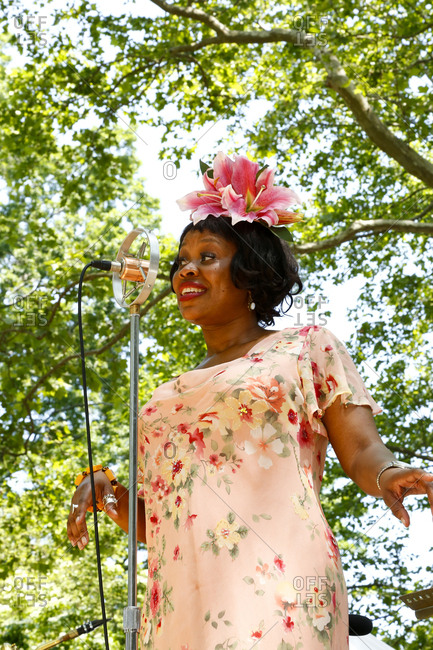 New York City, United States - June 10, 2017: 1920's Jazz Age Lawn Party at Governors Island, Woman in vintage clothing singing at a 1920s-themed party