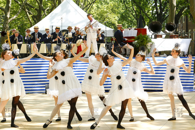 New York City, United States - June 10, 2017: 1920's Jazz Age Lawn Party at Governors Island, Showgirls in black and white costumes dancing at a 1920s party