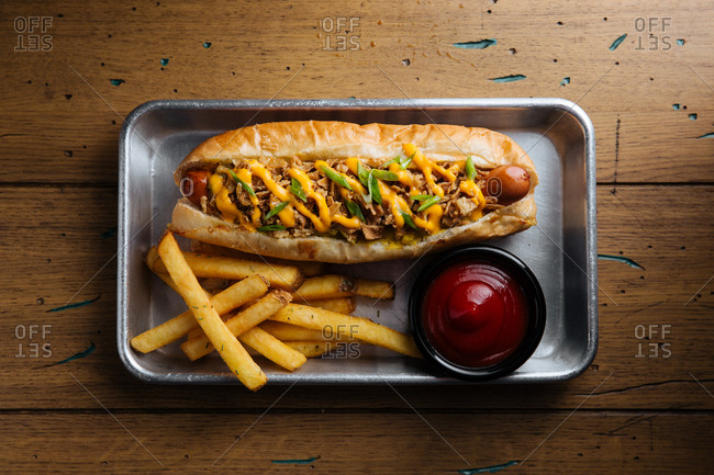 Hot dog with fries on silver tray
