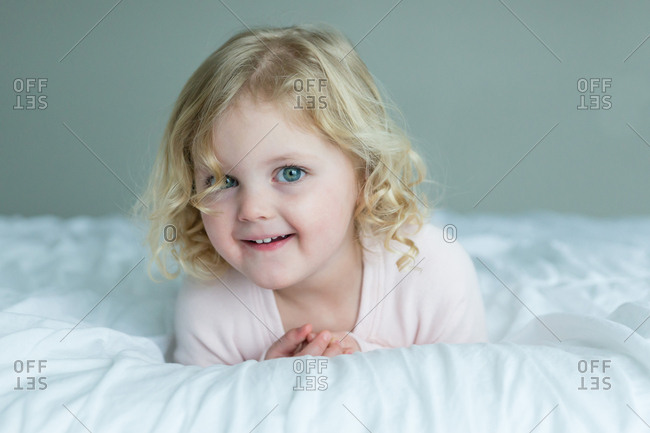 Pert blue eyed girl on blanket