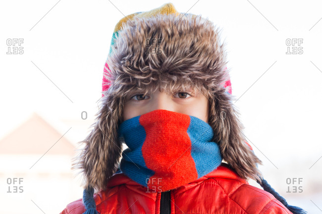 Portrait of boy wrapped in winter clothing