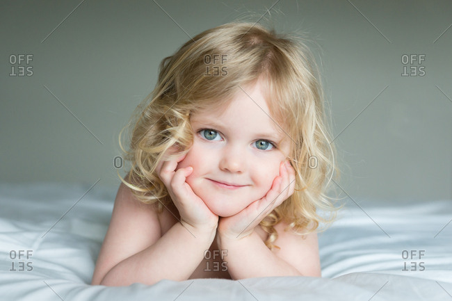Smiling blonde girl with blue eyes