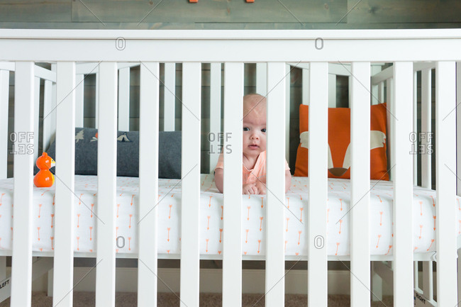Baby looking out his crib