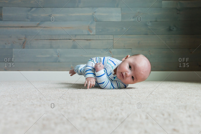 A baby rolling on floor