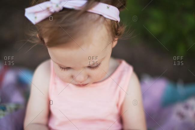 A little girl looking down