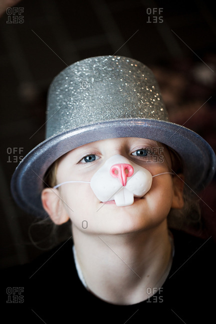 Portrait of girl wearing party hat and fake nose