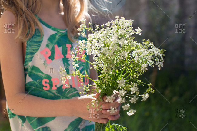 Close-up of girl holding yarrow flower bouquet